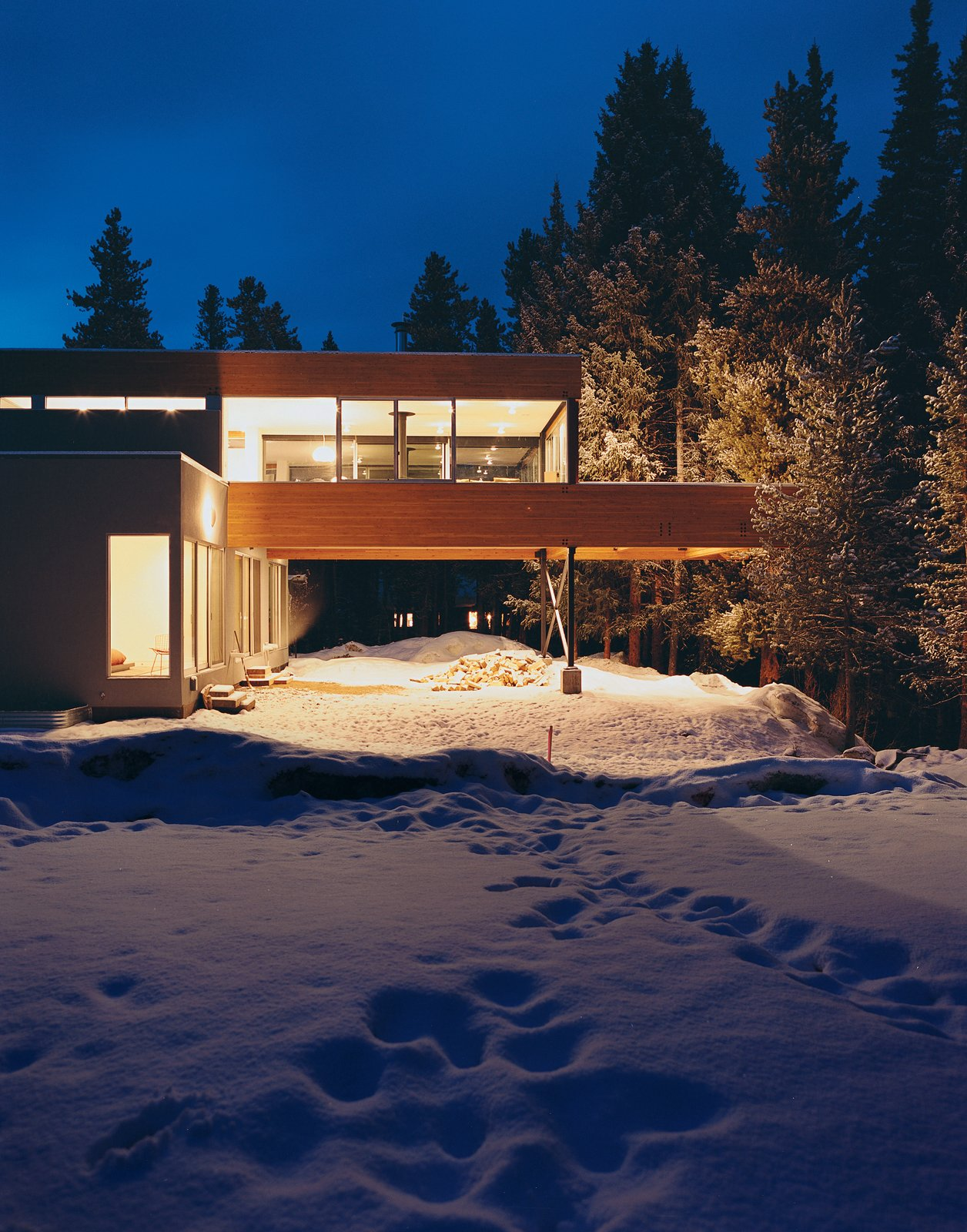Michael Johnson's answer to having little buildable land to work with in his design of Ruth Hiller's Winter Park, Colorado, house was to elevate and cantilever the kitchen, living, and dining space over the carport, nearly doubling the home's living area. 2nd floor by Tom Foley
