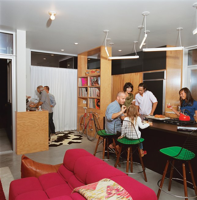 The resident wanted to be able to use the space as a fun gathering place for parties, so Bestor set a DJ booth at the edge of the kitchen. Custom plywood shelving holds vinyl records.  Photo 3 of 10 in How to Design a Kitchen That's Ideal For Entertaining—and Shop Our Picks from On the Edge: Modern Homes Designed for Extreme Sports