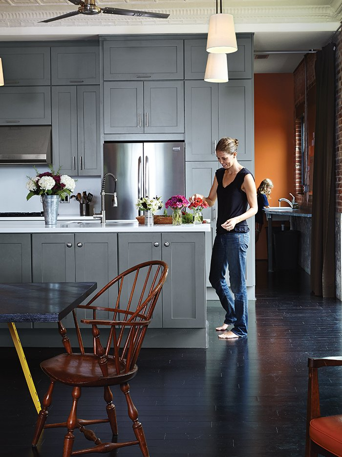 The cabinets, island, and countertops are KraftMaid and the appliances are Frigidaire, all from Lowe's. The espresso-colored bamboo flooring is by USFloors.  Photo 4 of 13 in Family-Friendly Renovation of a Brick Warehouse in Alabama