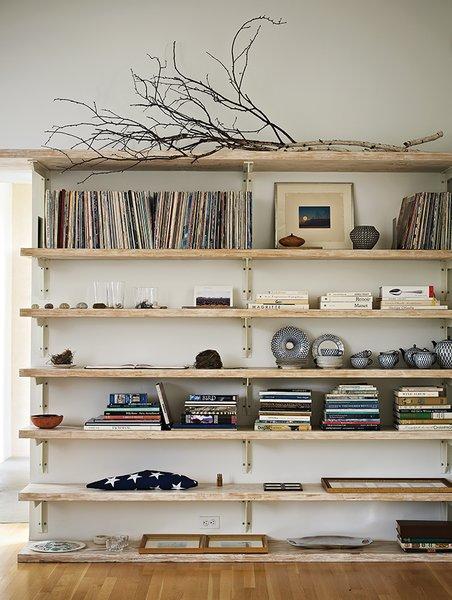 Built-in bookshelves in the living room hold Sanders's vinyl collection.