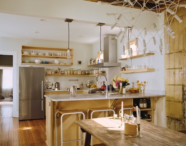 The trio of pendant lamps hanging above the counter came from Schoolhouse Electric Co. and were reworked by Peyton Avrett to fit the width of the header beam to which they are attached. The bar stools were gifted from a friend.
