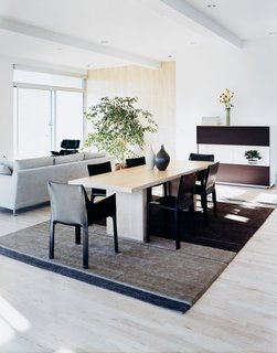 Modern Across America: Salt Lake City - Photo 3 of 6 - Cassina cab chairs and curvilinear vases from Vietnam create a sense of calm, and provide a warm contrast to the strong clean lines of the interior.