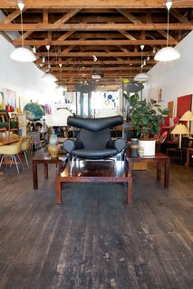 He's also found rosewood Milo Baughman tables <br><br>and an Ox Chair designed by Hans Wegner.