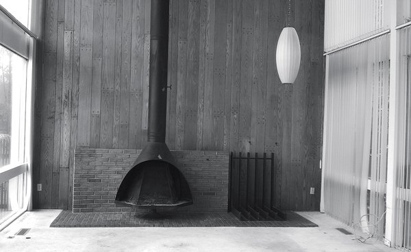 A George Nelson Cigar lamp and Malm fireplace were salvaged from the original living room.