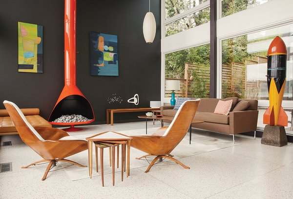 Two Seattle homeowners remade a soggy midcentury home as a thoroughly modern masterpiece by punching up vintage numbers with bold color. A pair of vintage George Mulhauser for Plycraft chairs is complemented by a powder-coated orange fireplace, a coffee table by Alexander Girard for Knoll, and a pair of undated paintings by Arthur L. Kaye.