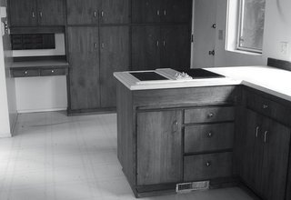 A Home's Past Mistakes Are Finally Corrected - Photo 8 of 14 - The original midcentury kitchen was dark and disconnected.