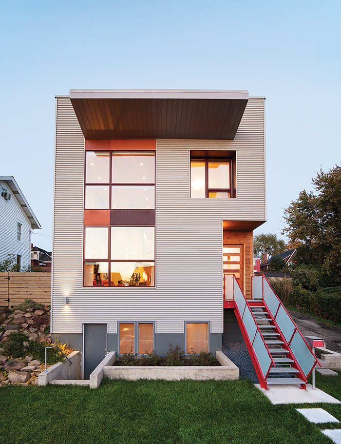 By using salvaged materials—such as a steel staircase—and doing much of the work themselves, Andrew Moss and Michelle Yanefski built their house in Pittsburgh's Lawrenceville neighborhood for $135 per square foot.  Photo 1 of 8 in Cost-Effective Family Home in Pittsburgh
