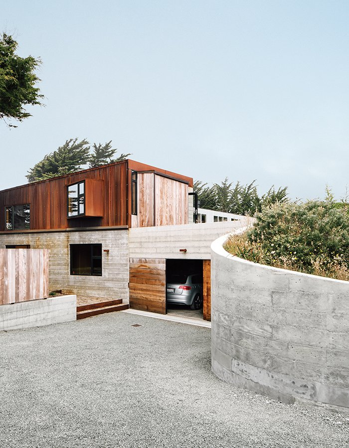 Cor-Ten steel and board-form concrete give the exterior a weathered look. Tagged: Exterior, House, Concrete Siding Material, Metal Siding Material, and Shed RoofLine.  Sea Ranch by DAVE MORIN from Modern Home Joins a Storied Site on the Pacific Ocean
