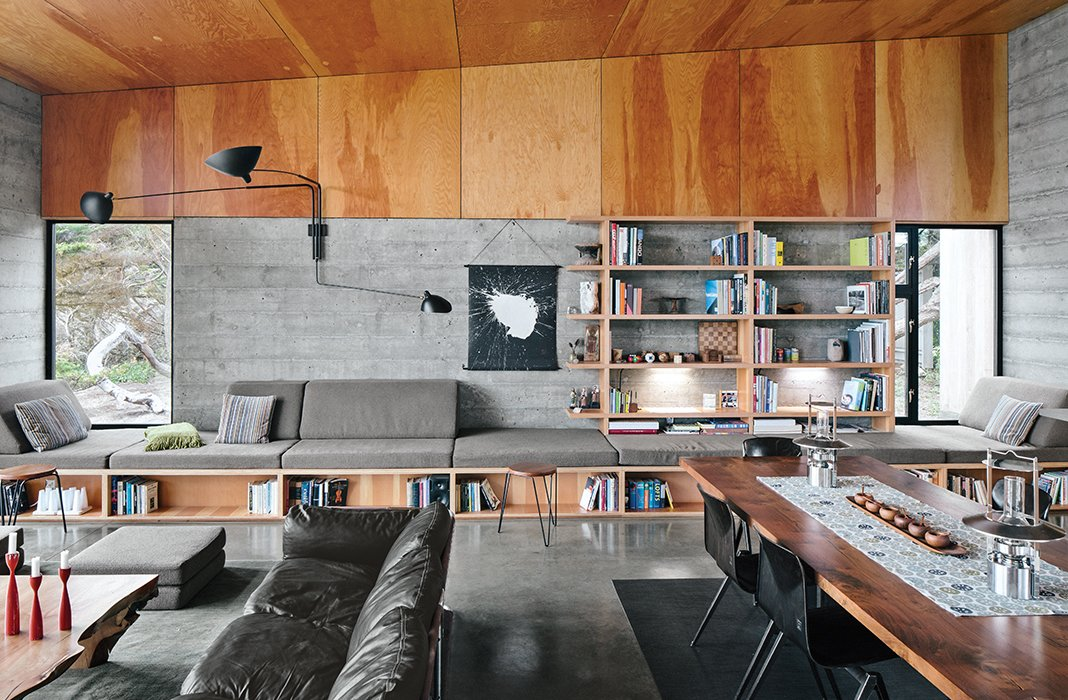 Norman Millar and Judith Sheine designed the built-ins in the living-dining area, which were made from vertical-grain Douglas fir. Vintage Dutch industrial chairs are arranged around a black walnut dining table that, like the madrone coffee table, is by Urban Hardwoods.
