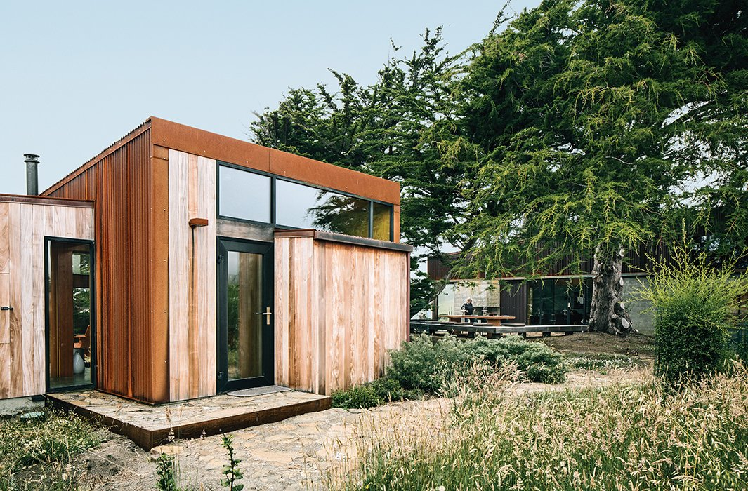 Sea caves on the property forced the architects to split some of the living space into a 483-square-foot guesthouse. Tagged: Shed & Studio and Living Space.  Sea Ranch by DAVE MORIN from Modern Home Joins a Storied Site on the Pacific Ocean