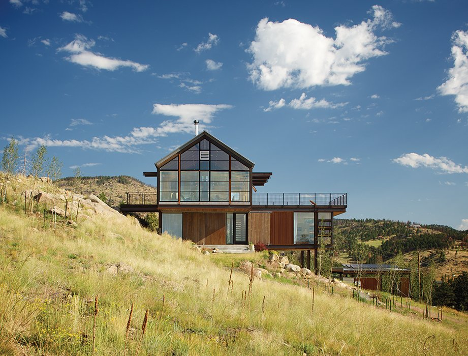 The house that architect Renée del Gaudio designed for her family in Boulder uses energy-efficient Loewen windows on the south facade that incorporate triple-paned low-e glass from Cardinal.  Cabins & Hideouts by Stephen Blake from Sustainable Retreat on a Fire-Devastated Site in Boulder