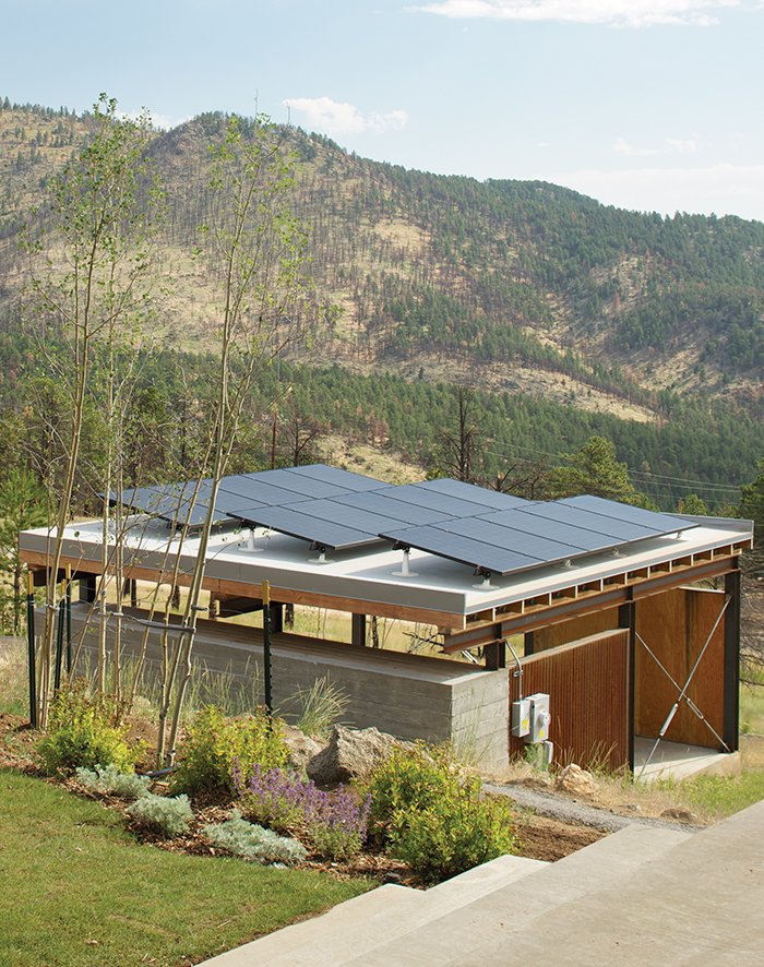 The Solar Revolution installed 3.6-kilowatt photovoltaic solar panels on top of the carport, which sports a board-formed concrete exterior and a cedar-slat-and-plywood interior. Sustainable Retreat on a Fire-Devastated Site in Boulder - Photo 2 of 7