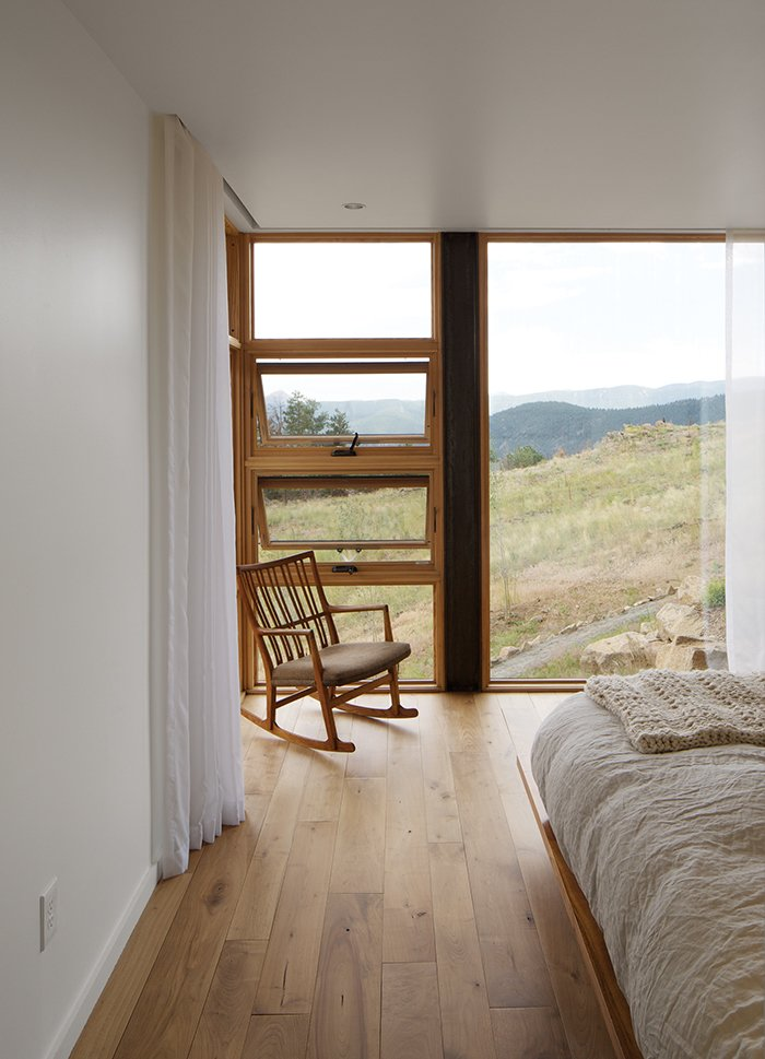 The house has no mechanical ventilation, only Hunter ceiling fans and opposing awning windows.  Bedrooms by Dwell from Sustainable Retreat on a Fire-Devastated Site in Boulder