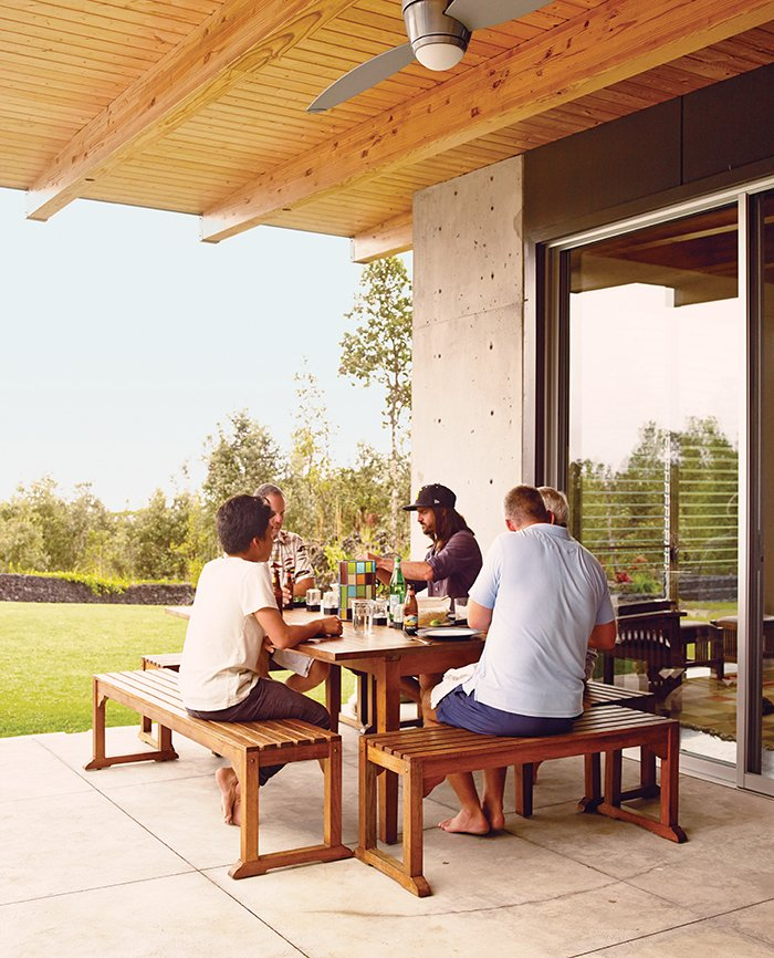 The couple entertain friends on one of several lanais that Steely added. The chaises are from Target. This House Conquers the Big Island in Hawaii - Photo 3 of 7