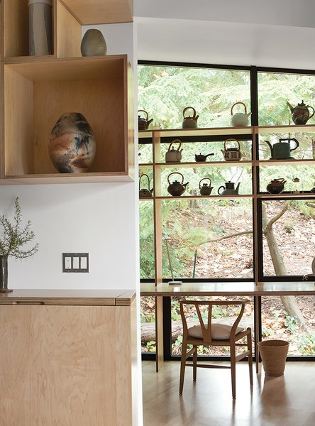 In the early stages of the addition concept process, Wibowo referred to a research publication from Australia, Dementia Care and the Built Environment, which underscores the importance of building a space that is as homelike as possible, with abundant light and many familiar objects in place. The architect accomplished this by creating custom shelving to hold ceramics that Ken made or collected over the years along with pieces by artist friends