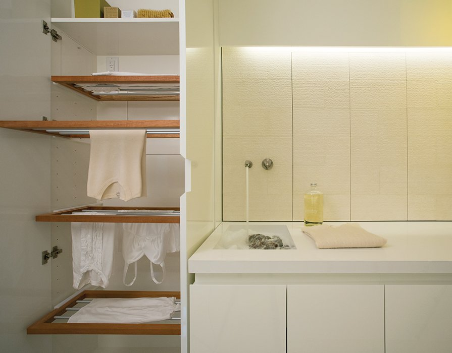 The cabinetry cleverly conceals everything, including a custom drying rack.