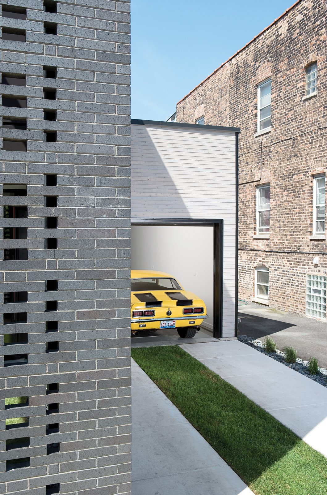 When open, the garage enables the owners to work on their vehicles while visiting with neighbors who do the same. Tagged: Garage and Attached Garage. The Brick Weave House in Chicago - Photo 10 of 10