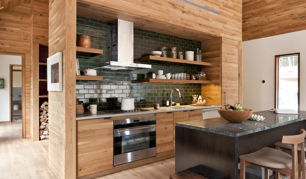 "All of the wood in the house—including the oak flooring, paneling, cabinetry and stairs—comes from companies run by the Hickman company in Pennsylvania. ""They have a compelling story that we were very drawn to and embraced,"" Lang says. ""They're a fourth-generation family-owned business, and they own and manage their own FSC-certified forest. They process their own wood, mill it into flooring, and sell directly."""