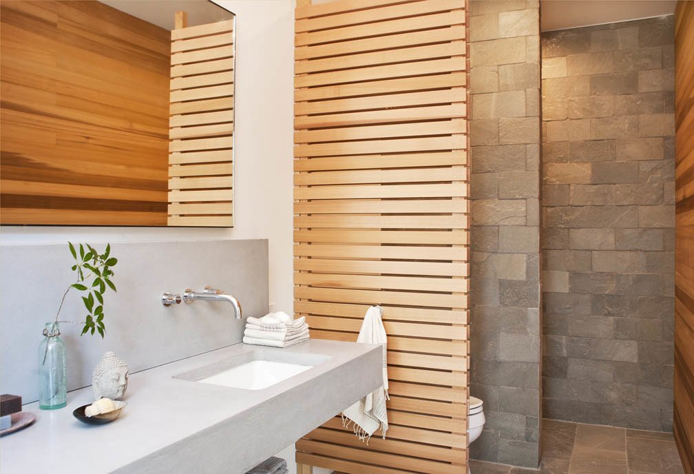 The master bathroom features a cedar screen and quartzite tiles by Walker Zanger. An Enclave of Modern Cottages in New York's Hudson Valley - Photo 8 of 10