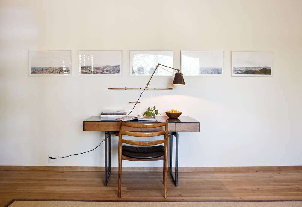 This desk was designed by William Lee, who runs a furniture store in Manhattan called Modernlink.  Photo 9 of 10 in An Enclave of Modern Cottages in New York's Hudson Valley