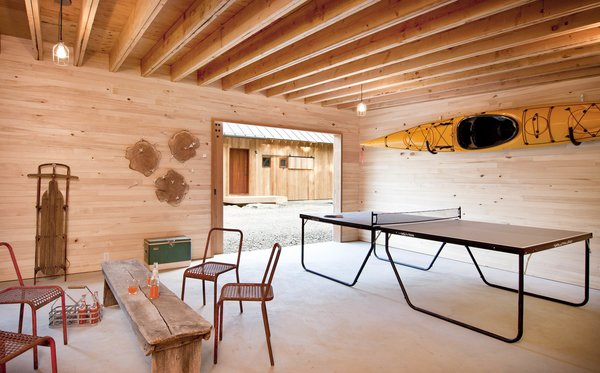 "The Langs use an outbuilding as a rec room of sorts. ""We call that the Grace Studio,"" Lang says. ""It's designed so a car can pull in there, but we use it as more of a rec room and work space."""