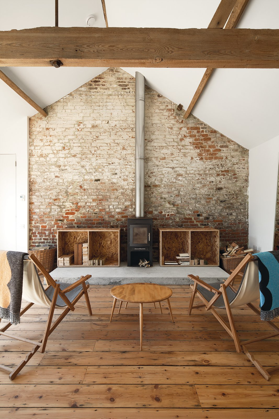 Floor Play  Turner reclaimed most of the timber used for the flooring as he renovated buildings in London. He thought his stockpile was big enough for the Ochre Barn, but the scale of the place defeated him. The solution, surprisingly, was eBay, turning up an old mill's worth of boards.  97+ Modern Fireplace Ideas by Dwell from Modern Brick Homes