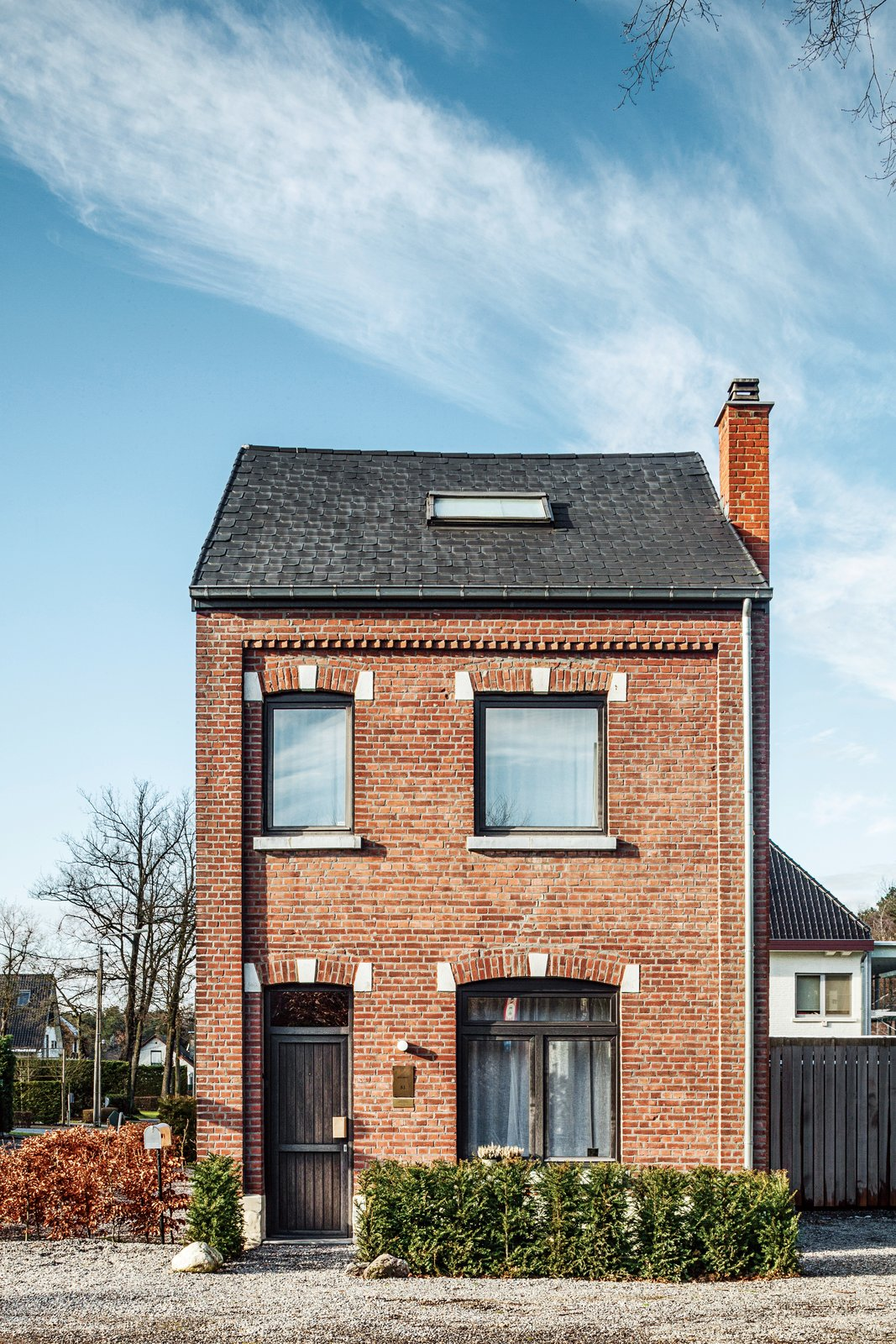 """""""We like to live close to work because we're constantly tinkering and adjusting, which is fine for us,"""" he says.  Photo 4 of 8 in A Clever Belgian Couple Renovate Their Aging Brick Home"""