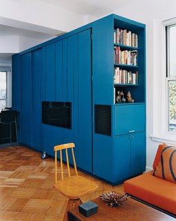 You Can Do It All in 450 Square Feet - Photo 2 of 5 - the blue-lacquered all-in-one cabinet in the fully closed position.