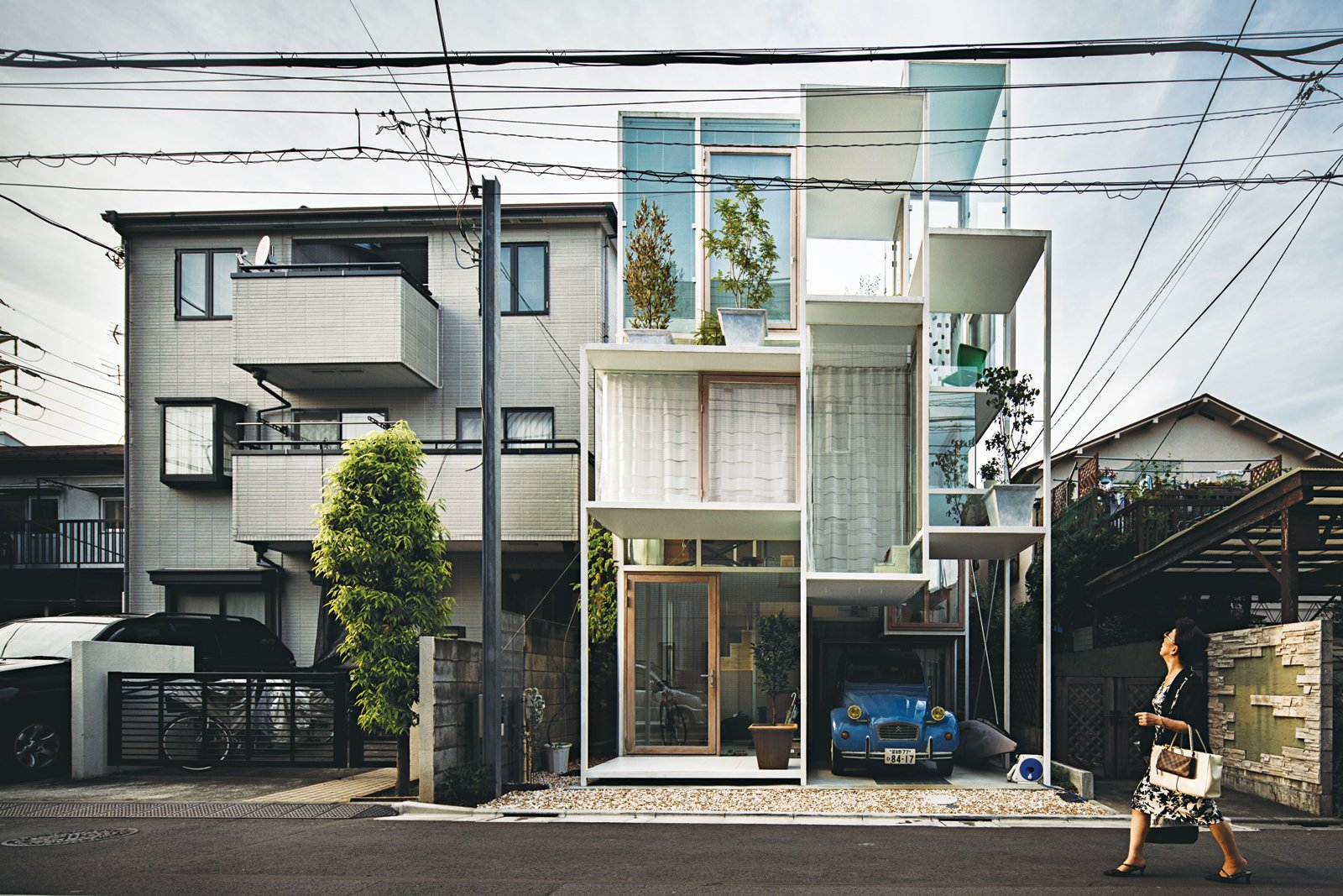 House NA from 2011 has glass walls and a steel structural frame containing a matrix of tiny rectangular rooms and outdoor terraces, each on a separate floor level linked by stairs, ladders, or movable steps. Hemmed in by neighboring homes on three sides and a narrow street in front, the house belongs to a couple clearly at ease with Tokyo's urban condition. Tagged: Exterior, Glass Siding Material, and House.  Photo 4 of 6 in Architect We Love: Sou Fujimoto