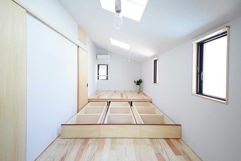 """The second floor features this clever storage design—a """"hidden space,"""" as co-design studio refers to it."""