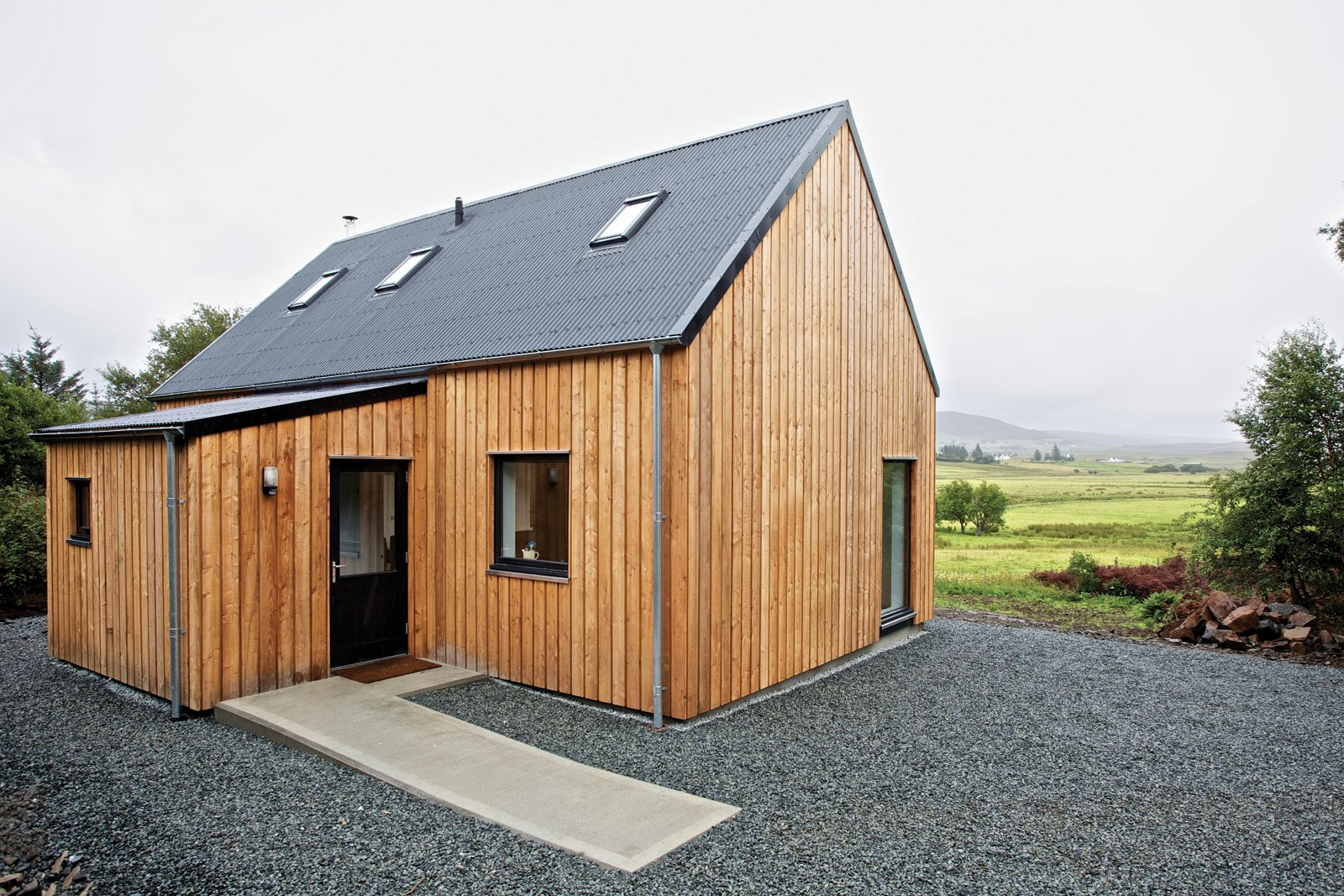 "This ""local prefab"" home on the Isle of Skye is made mostly from materials sourced in northern Scotland. The timber-framed model, meant to evoke the simple agrarian barns of the area, can be constructed on-site in as little as a day and is designed for affordability."