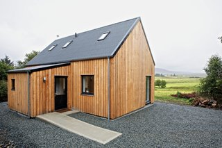 "8 Inspirational Island Prefabs - Photo 2 of 8 - This ""local prefab"" home on the Isle of Skye is made mostly from materials sourced in northern Scotland. The timber-framed model, meant to evoke the simple agrarian barns of the area, can be constructed on-site in as little as a day and is designed for affordability."