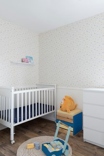 20 Cool Cribs for the Modern Baby - Photo 2 of 20 - Although the color palette is minimal, the couple added bursts of blue and yellow throughout the home in the living room and even the new nursery.