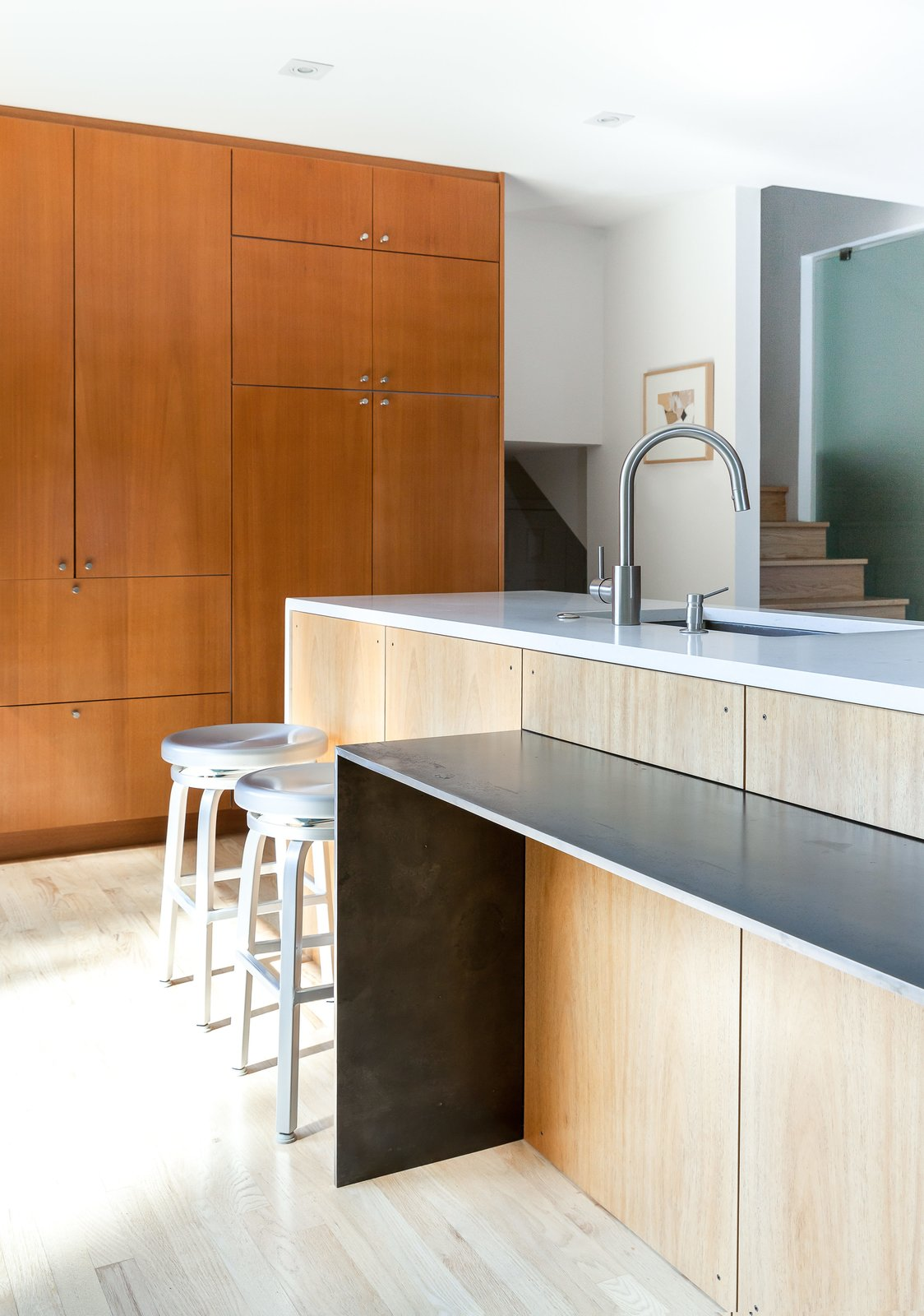 The dining table narrows to a counter attached to the island. Tagged: Kitchen and Wood Cabinet. A Completely Dysfunctional Nevada Kitchen Becomes Everyone's Favorite Spot for Parties - Photo 7 of 11
