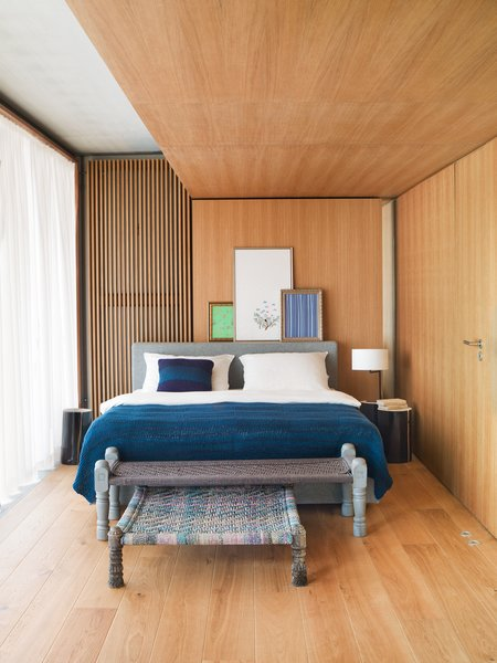 The cozy bedroom is clad in oiled oak.