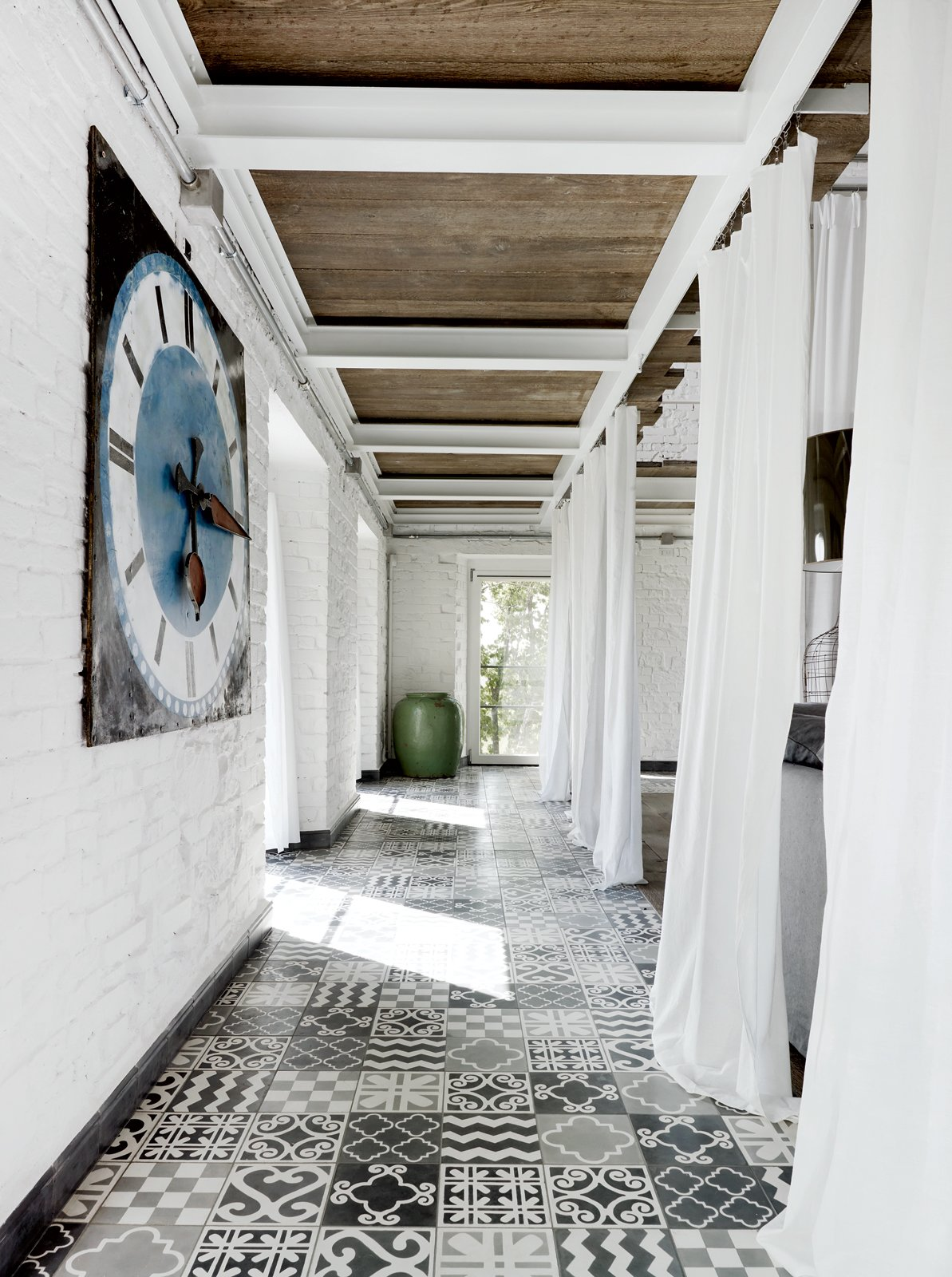 A carpet of custom tile created by Navone punctuates a corridor on the first floor. Tagged: Hallway and Ceramic Tile Floor.  Photo 6 of 13 in 12 Creative Ways to Use Tile in Your Home from Paola Navone's Industrial Style Renovation in Italy