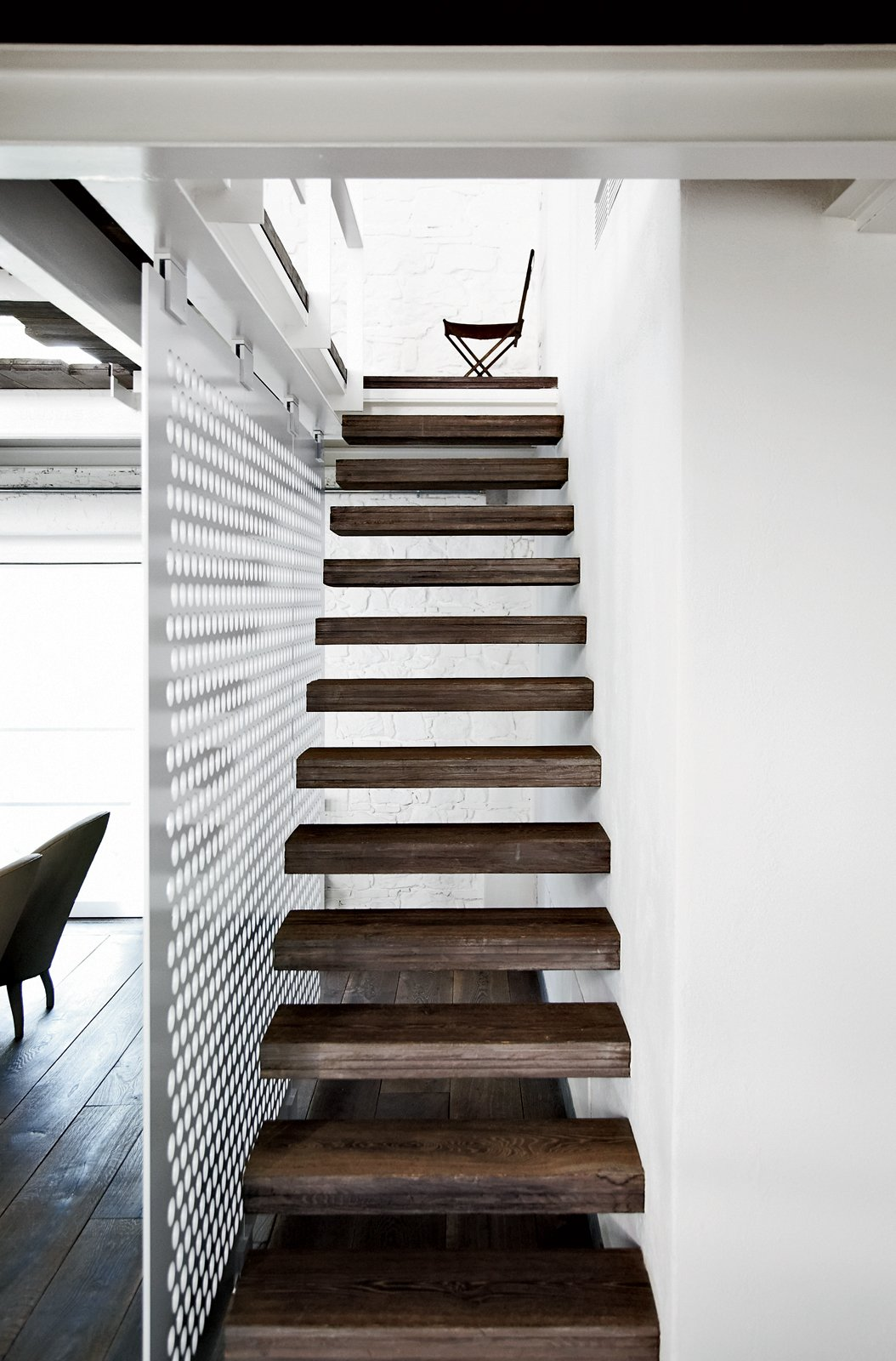The upper level of the 5,300-square-foot space is accessed via a slender stair with reclaimed-wood treads. Tagged: Staircase, Wood Tread, and Metal Railing.  190+ Best Modern Staircase Ideas by Dwell from Paola Navone's Industrial Style Renovation in Italy