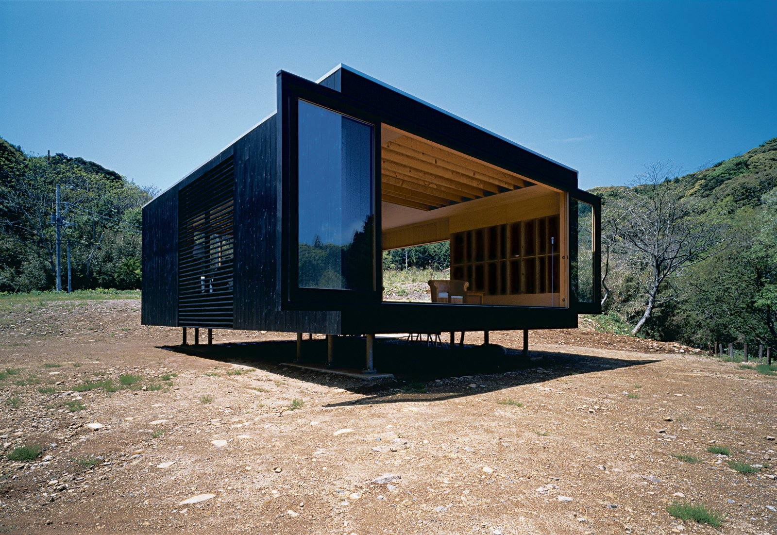 The resident, a Tokyo transplant, commissioned architect Tadashi Murai to create a fully-equipped structure that comes with its own power, heating and cooling, water, and waste-disposal systems. 15 Modern Homes with Black Exteriors - Photo 2 of 15