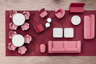 These 9 Spaces Show How to Rock a Monochromatic Color Scheme - Photo 2 of 9 - At the University of Lapland in Finland, interior design studio Silvola and Seppänen renovated a student common area for the art and design department with colorful, monochromatic seating areas. A darker pink carpet, with furniture in shades of blush, help delineate the space from the surrounding lounge areas. The pink-on-pink ultimately creates a layered, luxe feeling.