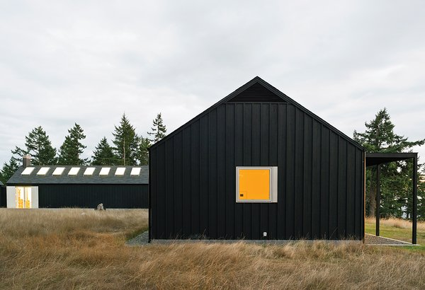 Architect Michelle Linden worked with Brothers to create a minimalist house. Inspired by the inward-looking approach of Cistercian abbeys, Linden oriented the U-shaped structure around a courtyard.