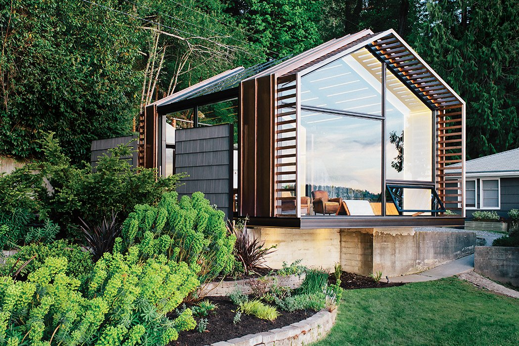 On Vashon Island, about 20 miles southwest of Seattle, architect Seth Grizzle designed a 440-square-foot multiuse structure for his clients Bill and Ruth True. Tagged: Exterior, Cabin Building Type, Glass Siding Material, Gable RoofLine, and Wood Siding Material.  Modern Spaces in the Pacific Northwest by William Lamb from Renovated Garage is the Ultimate Modern Party Space