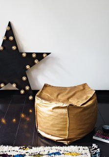 Inside Peter Fehrentz's Renovated Flat in Berlin - Photo 5 of 11 - The copper-colored leather pouffe is one of 48 DIY projects featured in Fehrentz's book, Made by Yourself. The English edition will be published in 2014.
