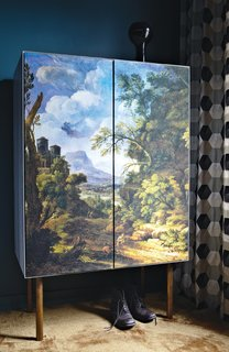 Fehrentz designed the wardrobe; the doors are covered in canvas printed with a baroque landscape scene. The curtains are by Dominique Kieffer.