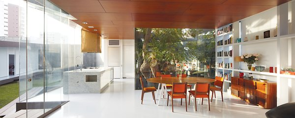 The dining area holds an adjunct kitchen designed for Lisette, a chef; the table base was repurposed from one from her former restaurant.