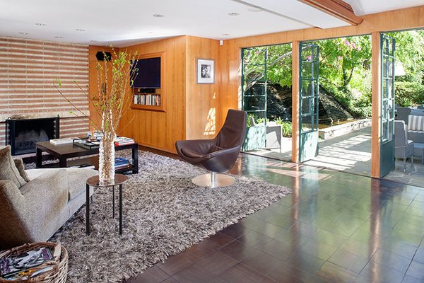 Like many of Wright's Los Angeles designs, the property prioritizes indoor/outdoor connection and rich materials including cypress paneling and Brazilian walnut tile flooring. Photo 2 of Warwick Evans House modern home