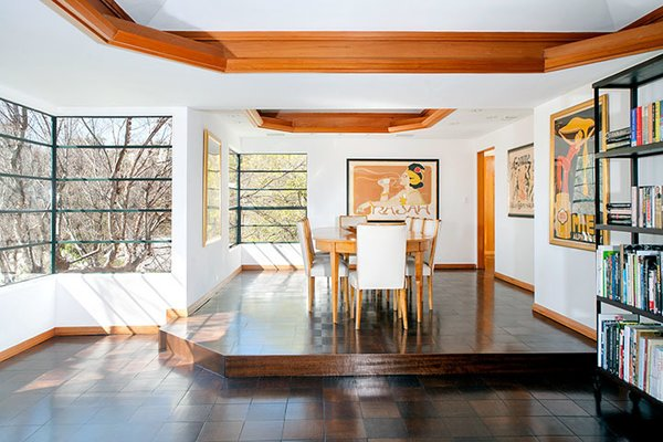 The elevated dining area room looks out onto the half-acre site. In recent years, the house has been restored. Photo 3 of Warwick Evans House modern home