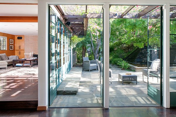 The yard is paved with Texas limestone and bluestone and features a Mayan-inspired koi pond. Photo 4 of Warwick Evans House modern home