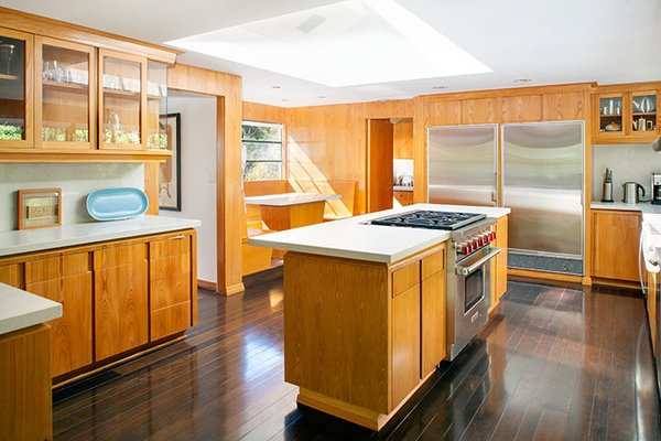 The kitchen is one area of the house that's been updated. The floors are ipe, and the appliances are by Wolf and Sub-Zero. Photo 7 of Warwick Evans House modern home