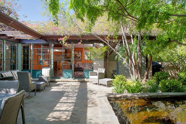 The house wraps around the patio and koi pond. Photo 8 of Warwick Evans House modern home