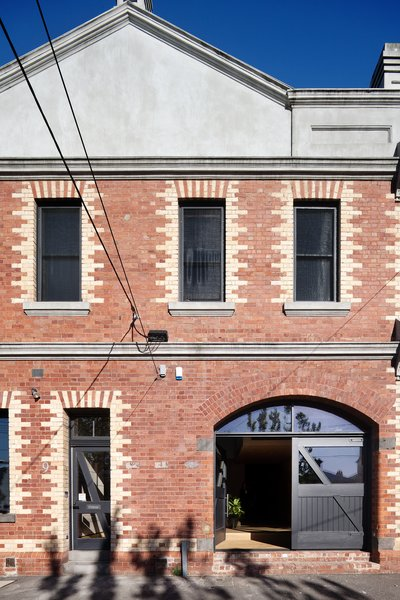 """The building is listed as a building of individual heritage significance,"" architect Andrew Simpson says of this two-story structure in Melbourne. ""There was very little scope to alter the exterior."" Photo  of Water Factory modern home"